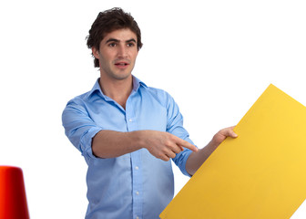 Young construction foreman with yellow sign