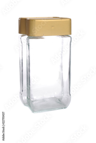Glass jar with a golden cover
