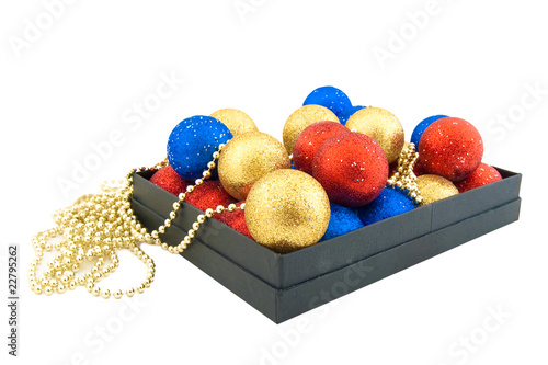 Set of blue,red and gold Christmas balls in a black box