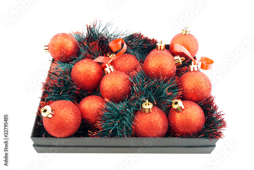 Set of red Christmas balls in a black box
