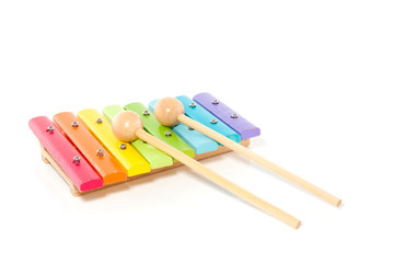 a colorful wooden xylophone isolated over white