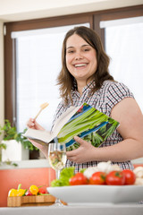 Cook - Plus size happy woman holding cookbook