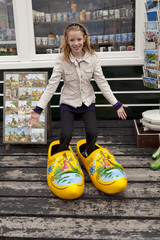 girl with big typical Dutch wooden shoes