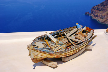 Old boat on the roof in Santorini island, Greece