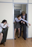 Colleagues struggle in doors  be first in boss`s office. poster
