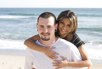 Young Happy Couple on the Beach