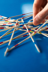 closeup of hand with pick-up-sticks