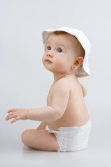 Infant in hat.