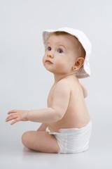 Infant in hat.