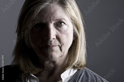 Senior Lady against Grey Background