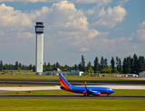 Air Traffic Control Tower and an Airplane on the Taxiway