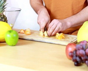 Slicing mandarine - Preparing fruit salad