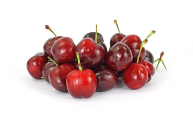 A group of several fresh cherries