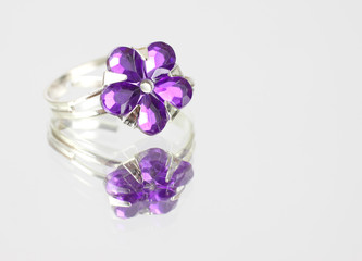 A costume jewelry ring with fake purple stones