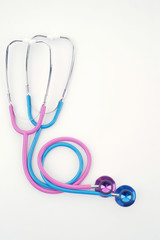pink and blue stethoscopes