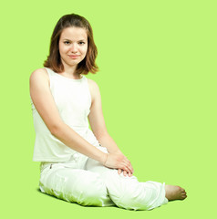 girl in white sitting on green