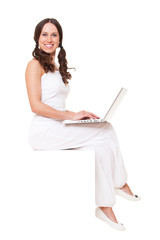 smiley woman with laptop