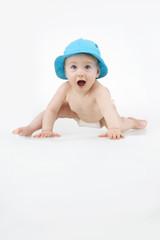 Infant in astonishment.
