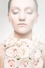 Woman with a rose necklace and wedding make-up