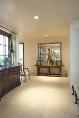 Spacious entrance hall with wooden furniture