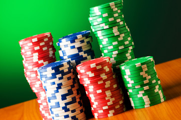 Stack of casino chips against gradient background