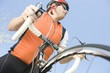 Male cyclist with metallic wheel rims