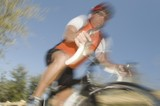 Male cyclist, blurred motion