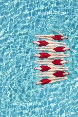 Synchronised swimmers balance head-to-toe