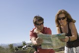 Mature couple on cycling holiday map reading