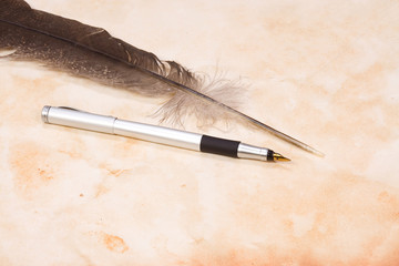 feather and silver pen