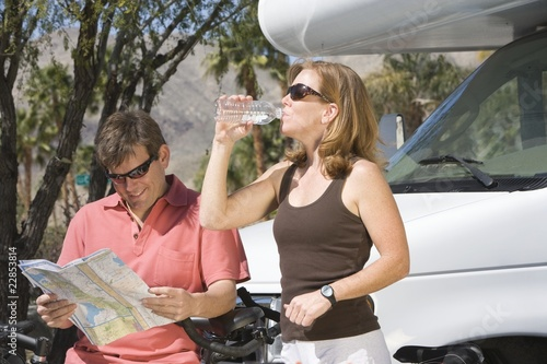Mature couple on cycling holiday with recreational vehicle