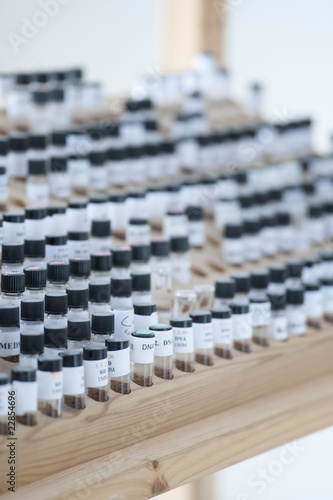 Vials in wooden stand
