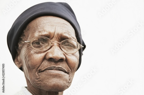 Senior woman in hat and spectacles