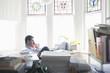 Businessman works from desk in bay window