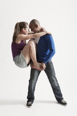 Man supports modern dance partner with barefeet