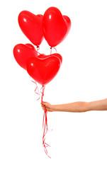 Hand holding heart ballons