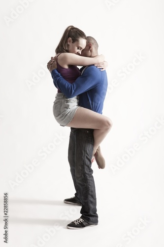 Modern dance couple embrace