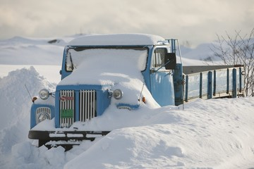 Truck is snowed in, Flakstadoya, Loftofen, Norway