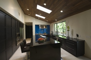 Black gloss kitchen with skylights