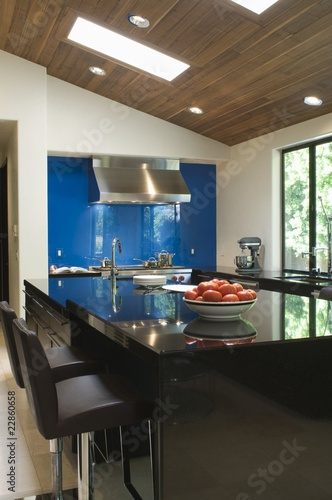 Blue splashback in black gloss kitchen