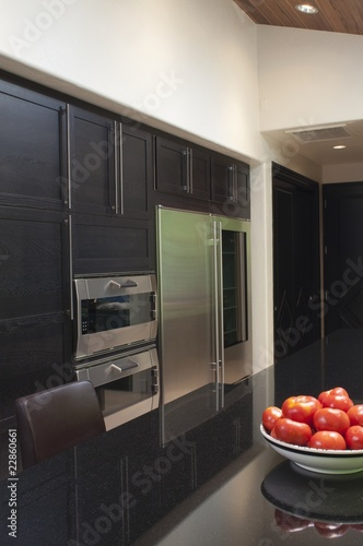 Fruitbowl of apples in black gloss kitchen