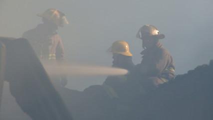 Fireman fighting fire in house