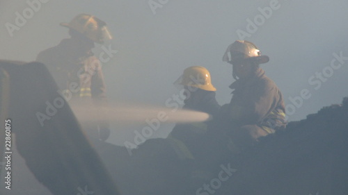 Fireman fighting fire in house