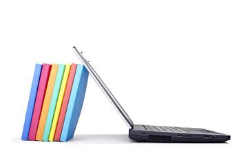 laptop computer books stack education school