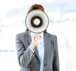 Portrait of an confident businesswoman using a megaphone