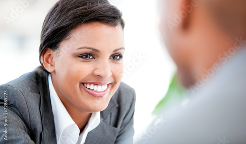 Portrait of a smiling businesswoman talking with her colleague