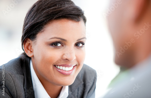 Portrait of a pretty businesswoman talking with her colleague