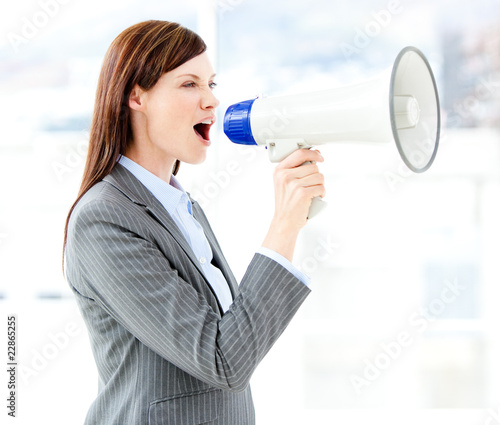 Portrait of an beautiful businesswoman using a megaphone