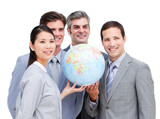 Portrait of a multi-ethnic businessteam holding a globe