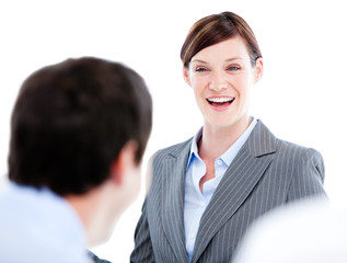 Portrait of a laughing businesswoman talking at her colleague du